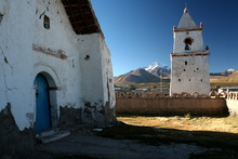Church in Village Isluga with Cabaray volcano in the background