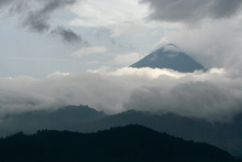 Volcan Santa Maria in storm clouds
