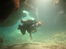 Andrea in a small cave, Underwater world by Dasa, Utila