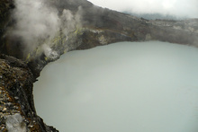 Boiling lake in the bottom of the active crater